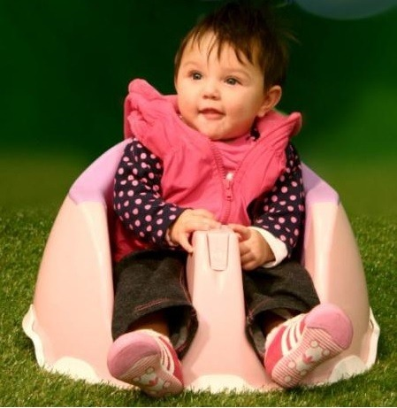 girl sitting in snappi baby chair
